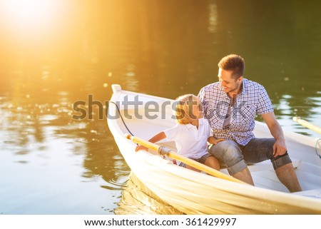 Father and son in boat - stock photo