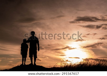 Father and son looking for future,  silhouette concept - stock photo