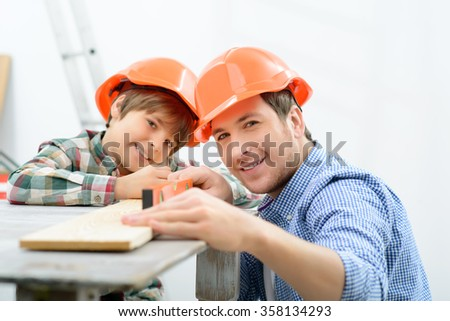 Father and son making renovation  - stock photo