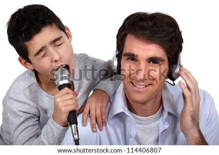 Father and son musical duo - stock photo