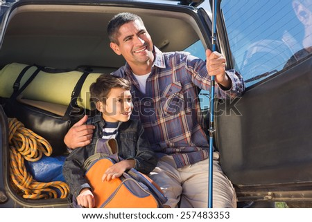 Father and son on a fishing trip on a sunny day - stock photo