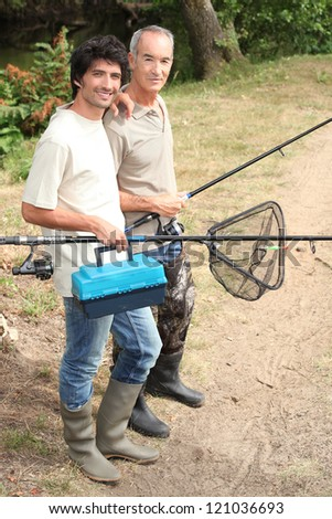 Father and son on fishing trip - stock photo