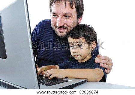 Father and son on laptop - stock photo