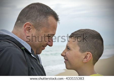 Father and son - people expression - stock photo
