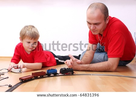 Father and son play a locomotive, railroad - stock photo