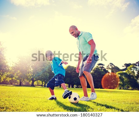 Father and Son Playing Ball in The Park - stock photo