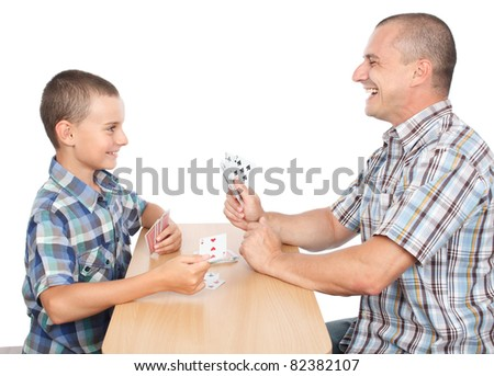 Father and son playing cards, isolated on white background - stock photo