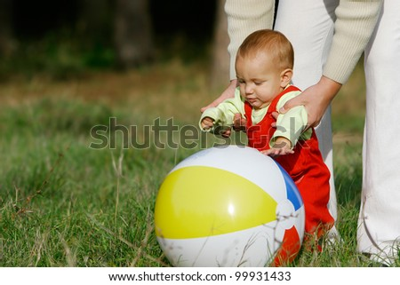 father and son playing on natural background - stock photo