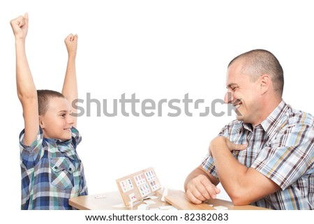 Father and son playing rummy, isolated on white background - stock photo