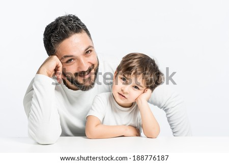 Father and son posing with positive real smile - stock photo