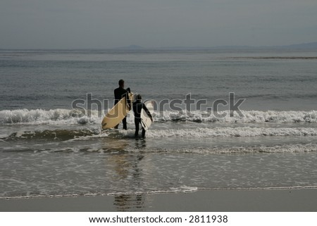 Father and Son Prepare to Surf in Southern California - stock photo
