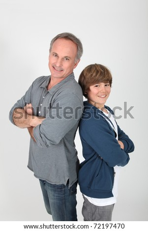 Father and son standing on white background - stock photo