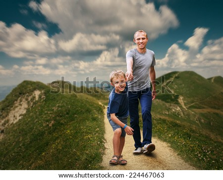 Father  and Son walking on the highmountain footpath - stock photo