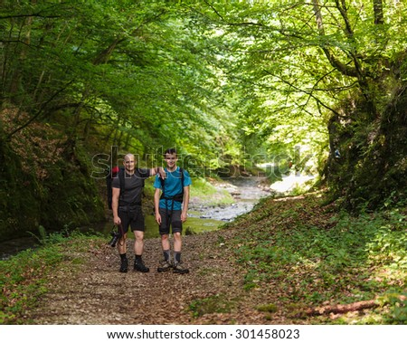 Father and son walking through a beautiful canyon - stock photo