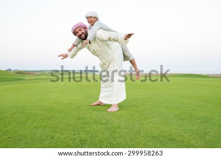 Father and sons in beautiful nature - stock photo
