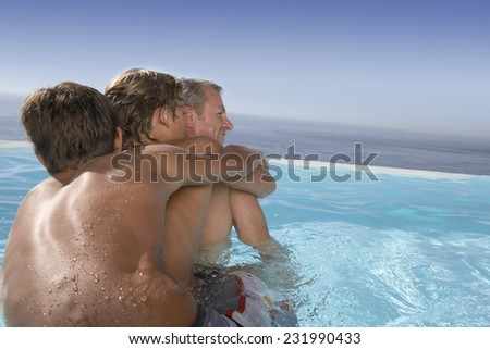 Father and Sons Playing Together in Pool - stock photo