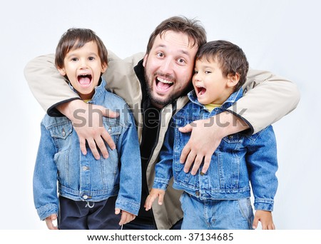Father and two boys in fall clothes - stock photo