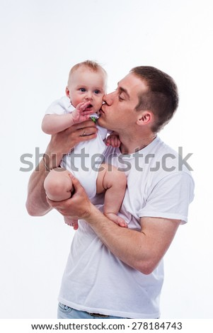 father baby studio white  - stock photo