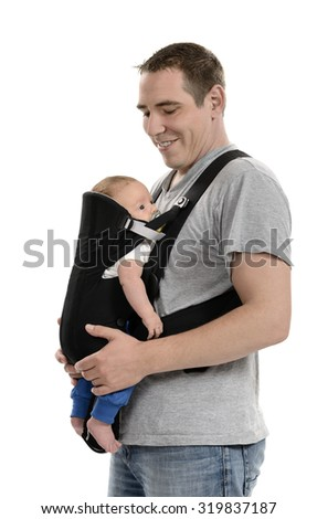 Father carrying his baby in carrier - stock photo