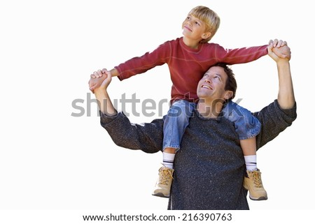 Father carrying son on shoulders, cut out - stock photo