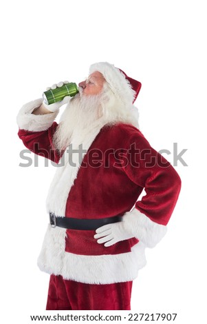 Father Christmas drinks beer with closed eyes on white background - stock photo