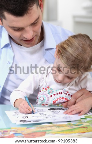 Father drawing with daughter - stock photo