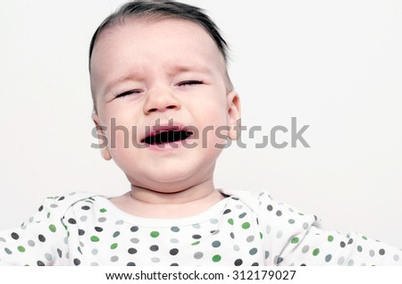 Father hand brushing with a comb his adorable baby hair - stock photo