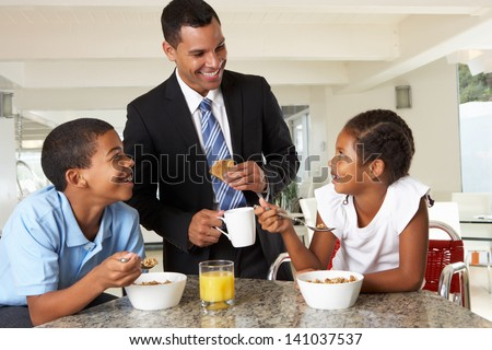 Father Having Breakfast With Children Before Work - stock photo