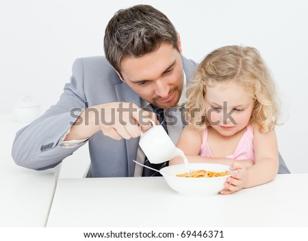 Father having breakfast with her daughter at home - stock photo