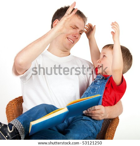 Father high-fives with his son on white background - stock photo
