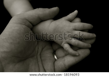Father holding his daughter's hand - stock photo