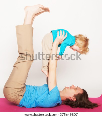 father  holding his little son on his feet - stock photo