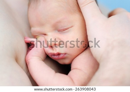 Father holding his sweet newborn baby  - stock photo