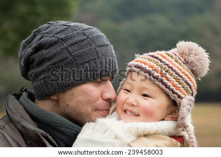 Father holding toddler  - stock photo