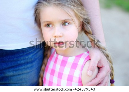 Father hugging little adorable sad daughter - stock photo