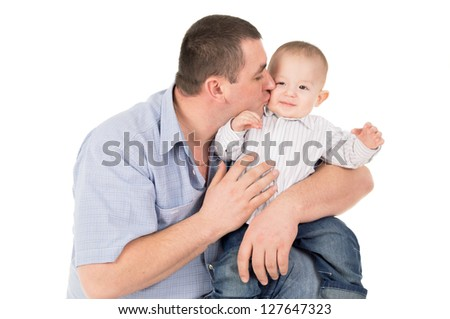 father kisses little son isolated on white background - stock photo