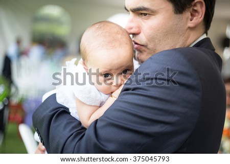 Father kissing his baby, and baby cry. - stock photo