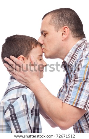Father kissing his son on the forehead, isolated on white - stock photo