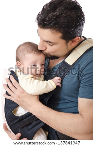 Father kissing little baby - stock photo