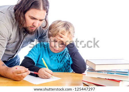 father leaning over to help son work one home work. Sitting at a desk with papers and books isolated on white with space for custom text - stock photo