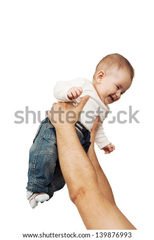 Father lifts his happy son up - stock photo