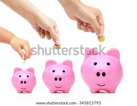 Father, mother, and baby in the family do saving money in pink piggy banks in three different sizes - stock photo