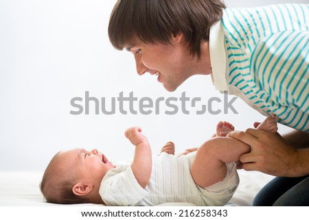 father playing with his cute baby - stock photo