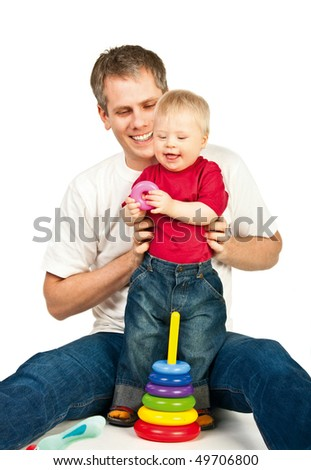 Father playing with his little son - stock photo