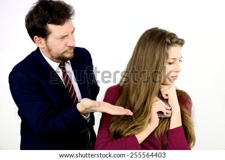 Father punishing daughter isolated in studio - stock photo