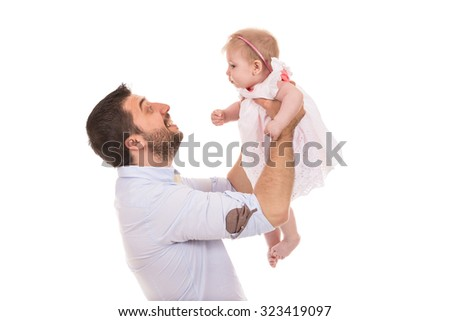 Father raising up his little baby girl isolated on white background - stock photo