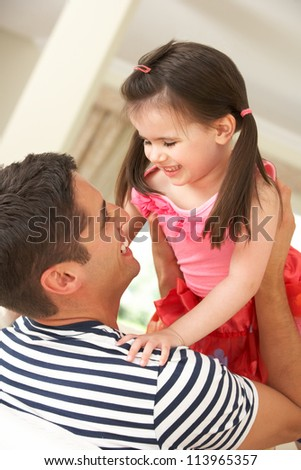 Father Relaxing At Home With Daughter - stock photo