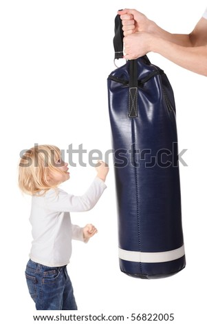 father's hands is holding punching bag and little girl is punching it. isolated. - stock photo