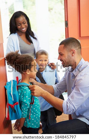 Father Saying Goodbye To Children As They Leave For School - stock photo