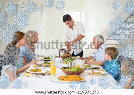 Father serving meal to family against snowflake frame - stock photo